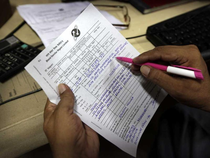 A telegraph officer checks a telegram message at the Kashmere Gate telegraph office in New Delhi. (AP Photo)