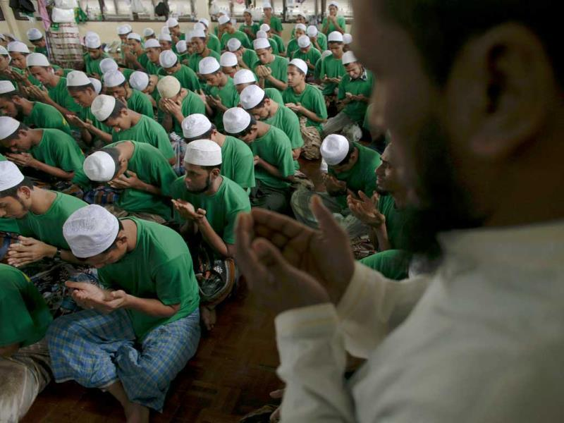 Rohingya Muslim illegal immigrants pray at the Immigration Detention Centre during the Muslim holy month of Ramadan in Kanchanaburi province. Reuters