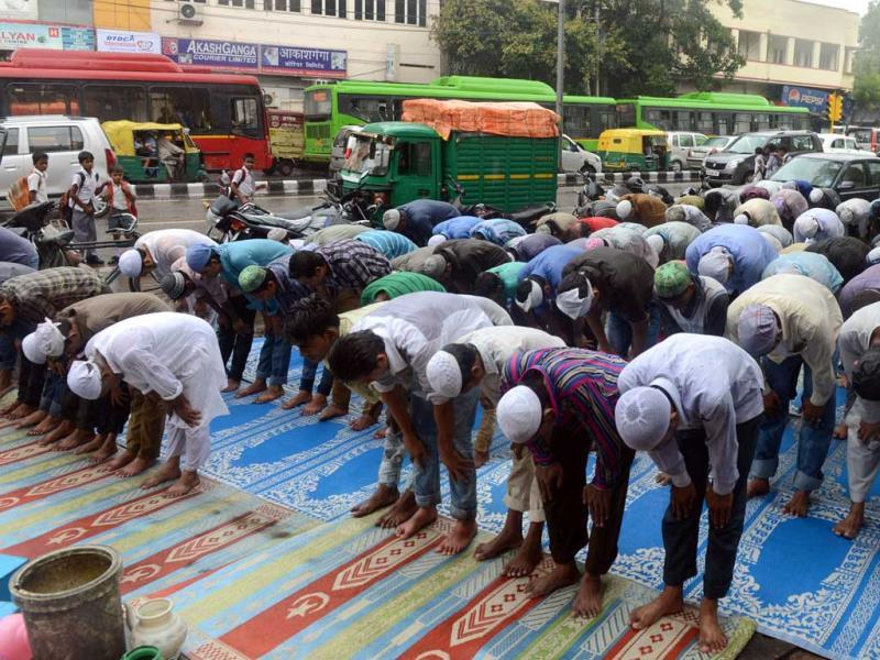 Indian Muslims, soaked from monsoon rains, pray on the streets outside a mosque as they perform the first congregational Friday prayers of the holy month of Ramadan in New Delhi. AFP Photo
