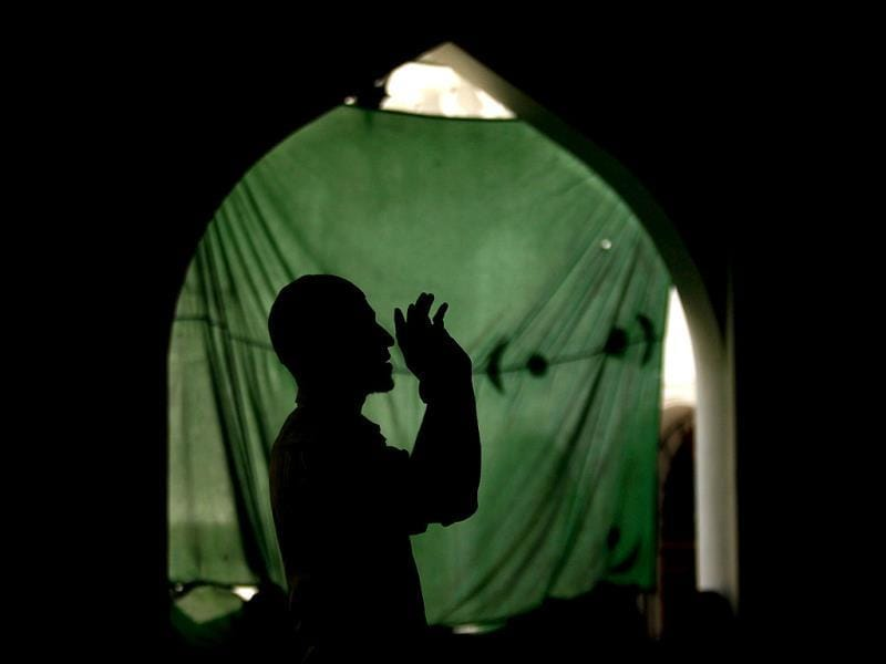 A Muslim man is silhouetted as he prays at a mosque during the month-long fasting on Ramadan in Colombo. Reuters