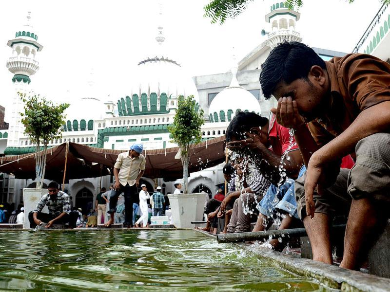 Indian Muslim devotees wash before praying during the second day of Ramadan at the Kharudin Mosque in Amritsar. AFP Photo