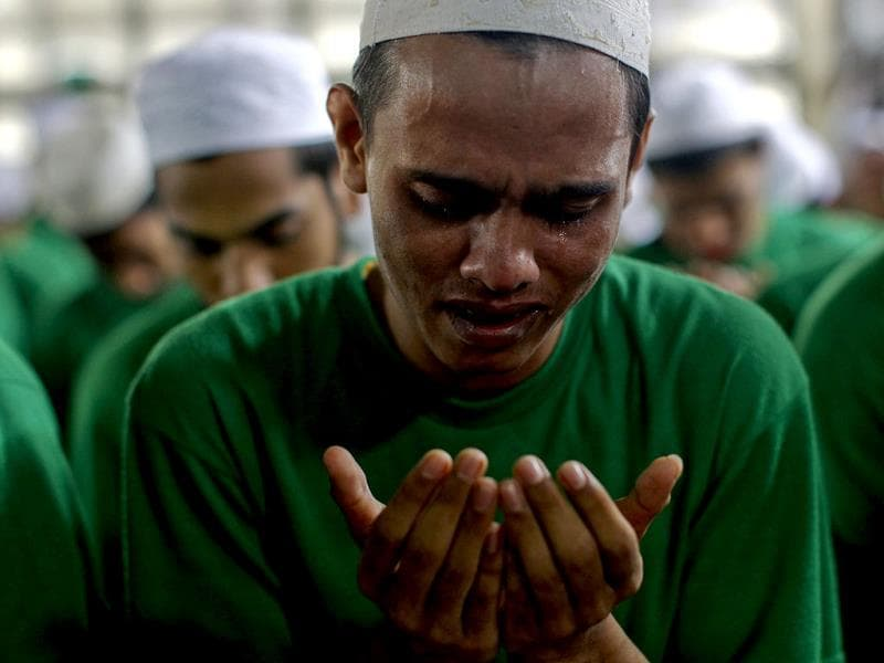 A Rohingya Muslim illegal immigrant cries as he prays at the Immigration Detention Centre during the Muslim holy fasting month of Ramadan in Kanchanaburi province. Reuters
