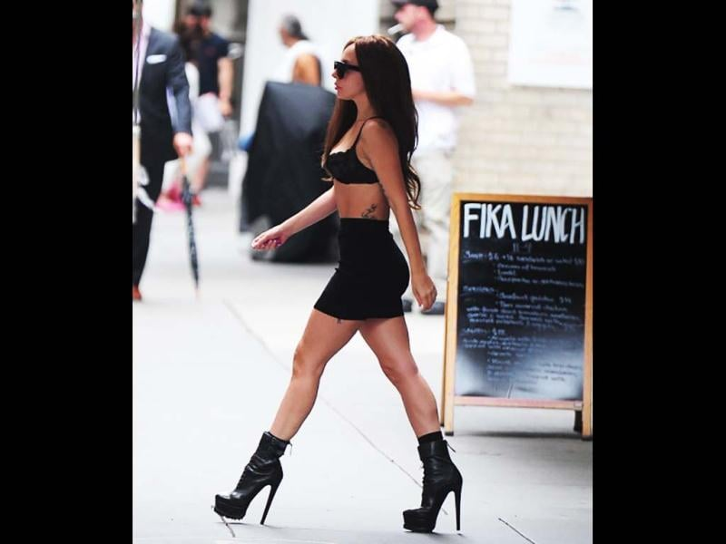 Lady Gaga struts about in NYC in a bra and in style.