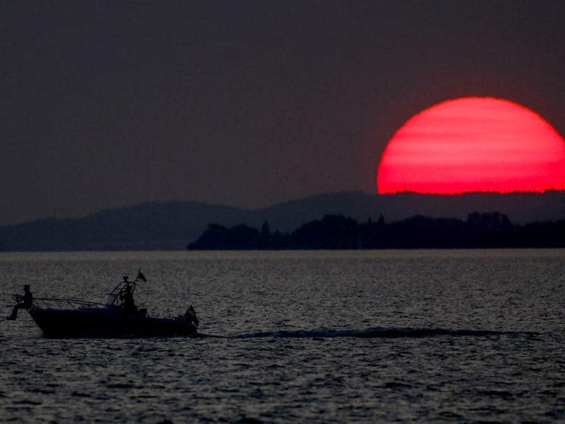 A boat is pictured in Lake Bodensee during sunset, in the western Austrian city of Bregenz. (Reuters)