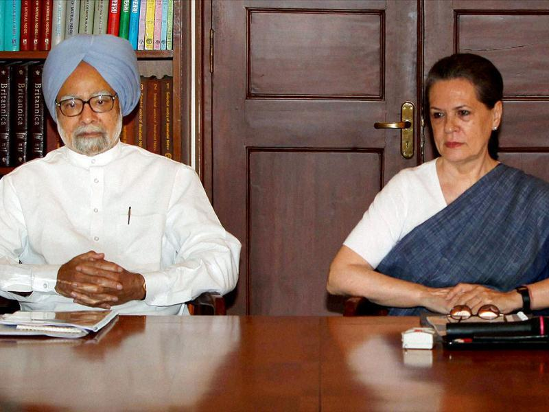 Congress president Sonia Gandhi with Prime Minister Manmohan Singh during the meeting of party chief ministers and state unit chiefs on Food Security roll out in New Delhi. PTI Photo