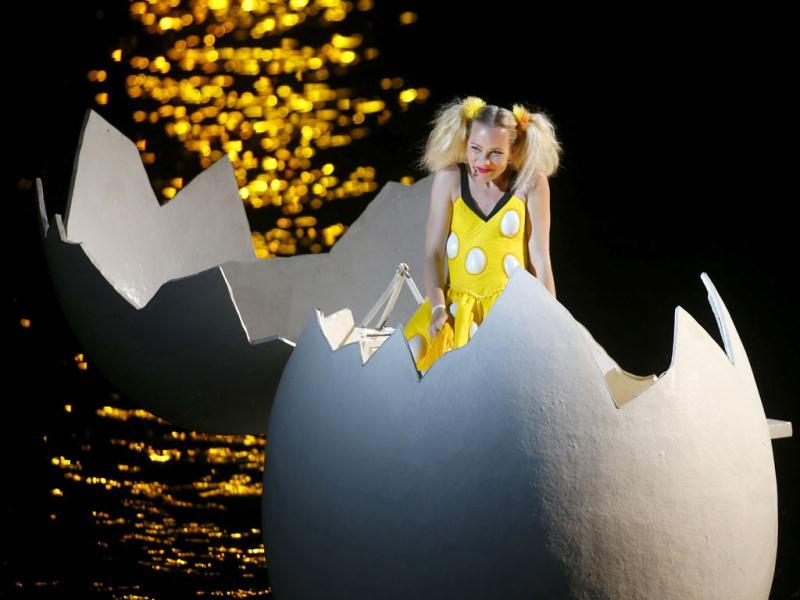 Singer Denise Beck, as Papagena, performs during a dress rehearsal for the opera 'Die Zauberfloete' by Mozart, on a giant floating stage at Lake Constance in Bregenz. (Reuters Photo)
