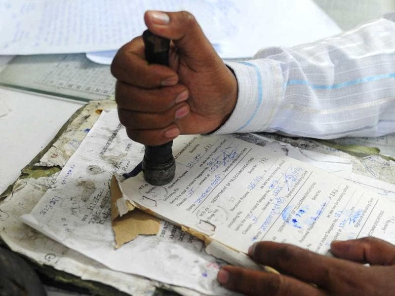 An employee stamps a telegraph message at Katchehri telegraph office, in Allahabad. (AFP Photo)