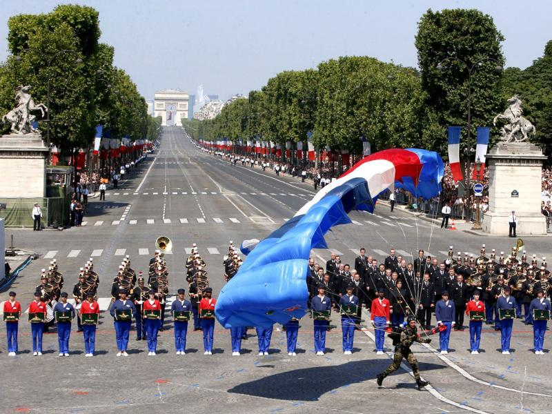 A paratrooper lands on Concorde Square during the Bastille Day parade in Paris. (AP Photo)