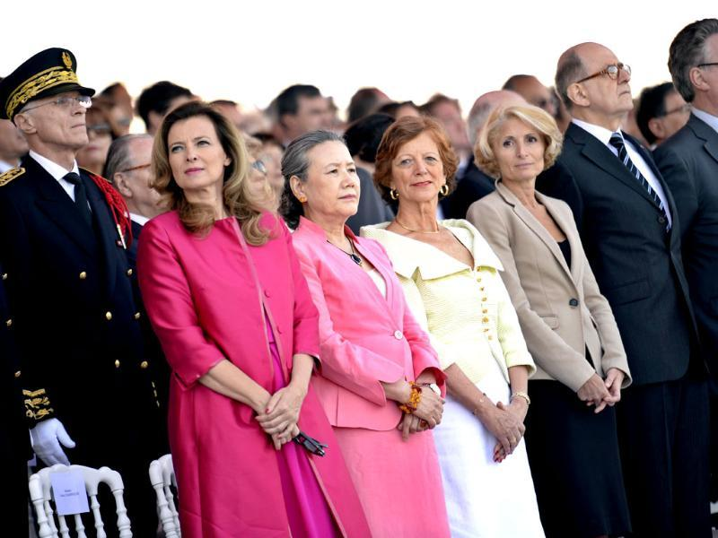 The partner of French President Valerie Trierweiler attends the Bastille Day parade next to the wife of Ban Ki-moon Yoo soon-taek in Paris. (AFP Photo)