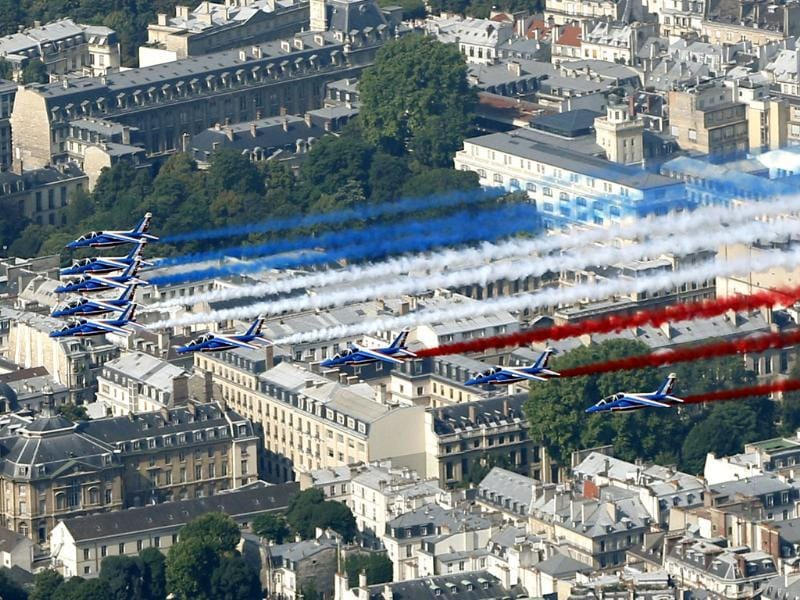 The French aerial display team Patrouille de France flies over the capital as part of the traditional Bastille day military parade in Paris. (Reuters Photo)