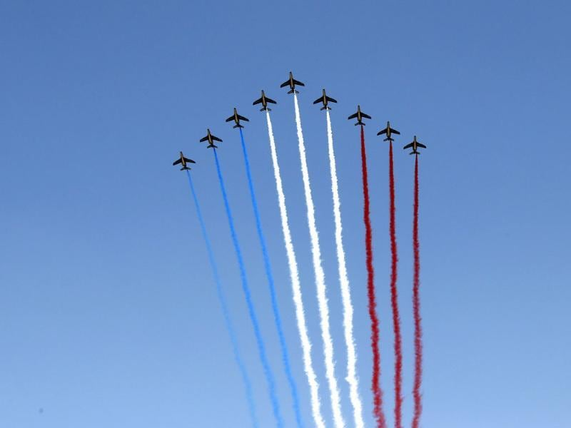 Nine alphajets from the French Air Force Patrouille de France fly during the traditional Bastille day military parade in Paris. (Reuters Photo)