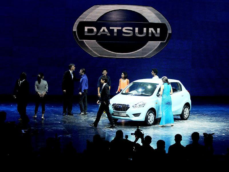 Performers and officials during the launched. Japanese carmaker Nissan resurrected its iconic budget Datsun marque to woo a new generation of economy-minded buyers. (AFP PHOTO)
