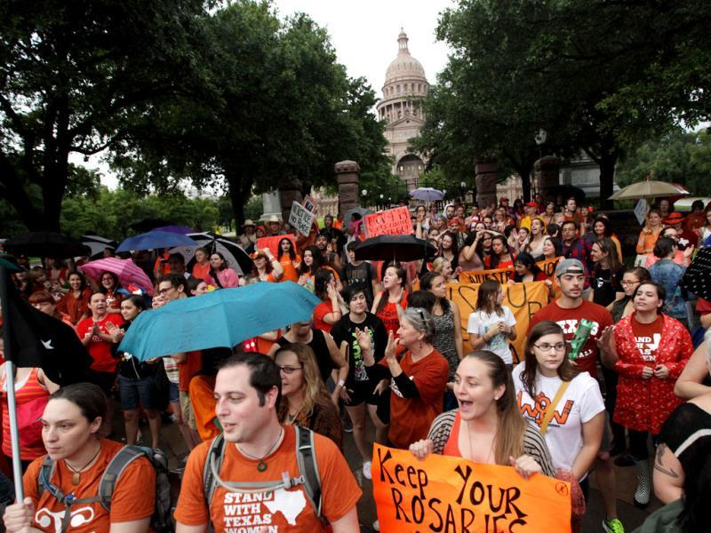 Abortion rights demonstrators rally outside the state Capitol to protest recent legislation that restrict abortion rights throughout the state in Austin, Texas. (AP Photo)