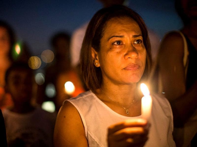 Candida Feliz participates in a candle lit vigil for Trayvon Martin, the teenager who was shot and killed in Florida last year, in New York City. (AFP Photo)