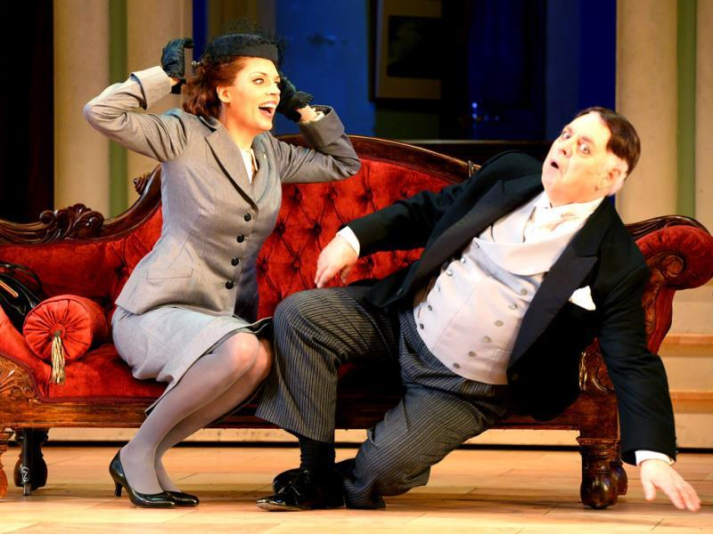 'Don Pasquale' falls off the sofa as 'Norina' looks on in the Opera Australia production of Donizetti's comic opera Don Pasquale, in Sydney. (AFP Photo)