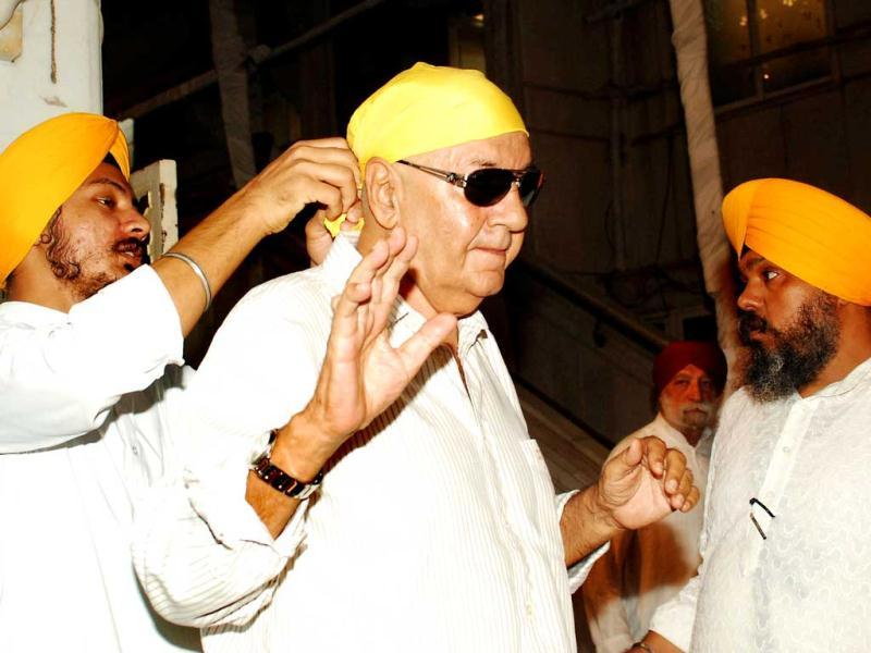 Actor Prem Chopra gets a cloth tied to his head at the prayer meet.