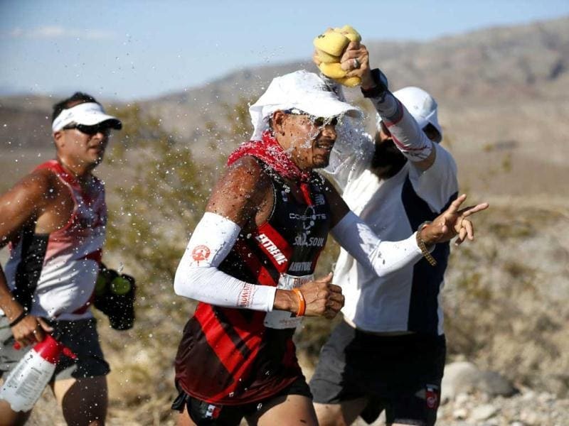 Oswaldo Lopez of Mexico, 41, (C) is doused with water during the Badwater Ultramarathon in Death Valley National Park, California. The 135-mile (217 km) race, which bills itself as the world's toughest foot race, goes from Death Valley to Mt Whitney, California in temperatures which can reach 130 degrees Fahrenheit (55 Celsius). REUTERS/Lucy Nicholson