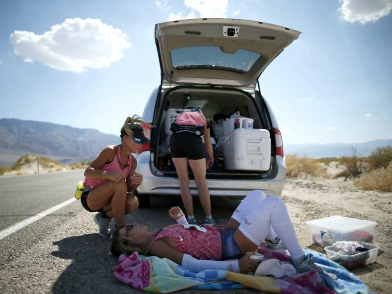 Shannon Farar-Griefer, 52, of Hidden Hills, California (lying down), is attended to by her team after stopping to drink water as she competes in the Badwater Ultramarathon in Death Valley National Park, California. The 135-mile (217 km) race, which bills itself as the world's toughest foot race, goes from Death Valley to Mt. Whitney, California in temperatures which can reach 130 degrees Fahrenheit (55 Celsius). REUTERS/Lucy Nicholson