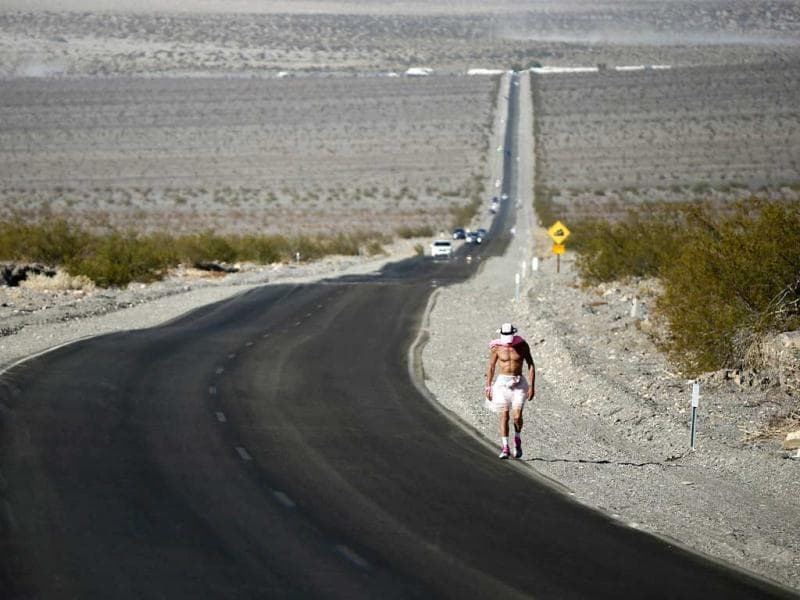 Keith Straw, 58, competes during the Badwater Ultramarathon in Death Valley National Park, California. The 135-mile (217 km) race, which bills itself as the world's toughest foot race, goes from Death Valley to Mt Whitney, California in temperatures which can reach 130 degrees Fahrenheit (55 Celsius). REUTERS/Lucy Nicholson