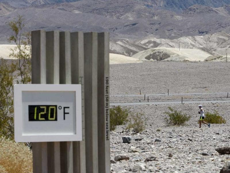 A competitor passes the unofficial thermometer at Furnace Creek Visitor Center during the AdventurCORPS Badwater 135 ultra-marathon race in Death Valley National Park, California. David McNew/Getty Images/AFP