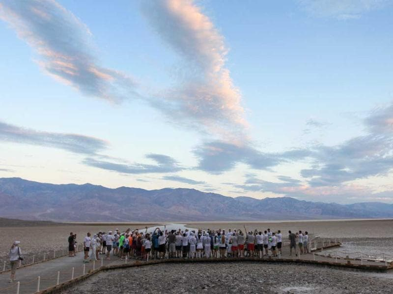 Runners gather at Badwater Basin for the start of the AdventurCORPS Badwater 135 ultra-marathon race in Death Valley National Park, California. Billed as the toughest footrace in the world, the 36th annual Badwater 135 starts at Badwater Basin in Death Valley, 280 feet below sea level, where athletes begin a 135-mile non-stop run over three mountain ranges in extreme mid-summer desert heat to finish at 8,350 feet above sea level near Mount Whitney for a total cumulative vertical ascent of 13,000 feet. David McNew/Getty Images/AFP