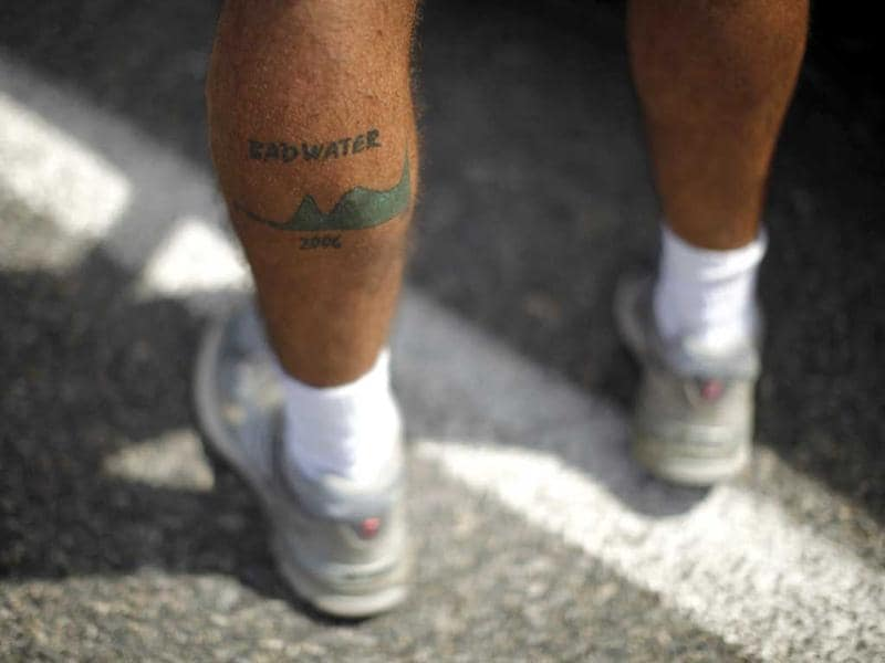 A man shows a Badwater tattoo during the Badwater Ultramarathon in Death Valley National Park, California. The 135-mile (217 km) race, which bills itself as the world's toughest foot race, goes from Death Valley to Mt. Whitney, California in temperatures which can reach 130 degrees Fahrenheit (55 Celsius). REUTERS/Lucy Nicholson