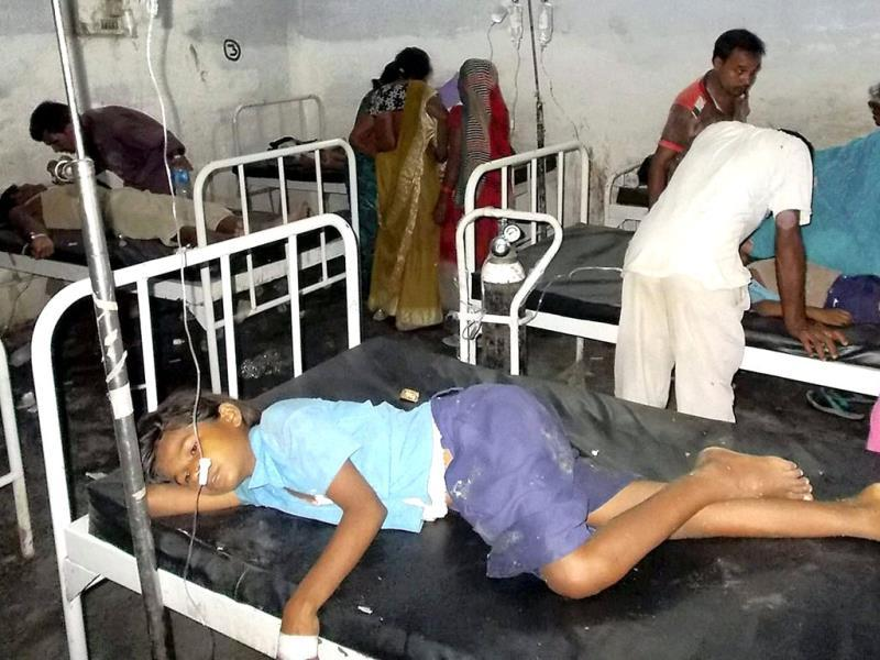 School children receive treatment at a hospital after they fell ill after eating a free meal at a primary school in Bihar's Chhapra district. (AP Photo)