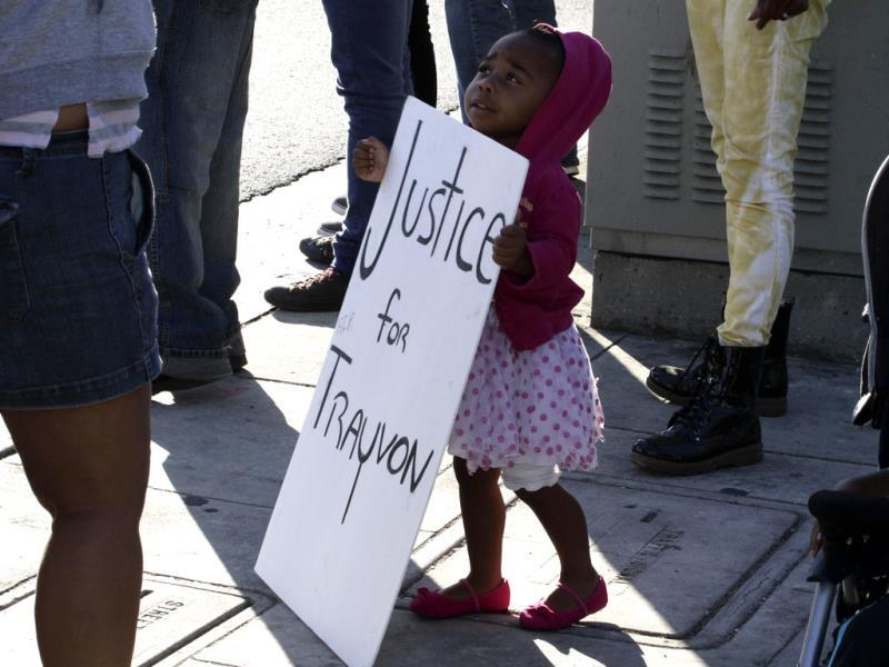A girl holds a sign during a demonstration supporting Trayvon Martin in Los Angeles, California. (Reuters Photo)