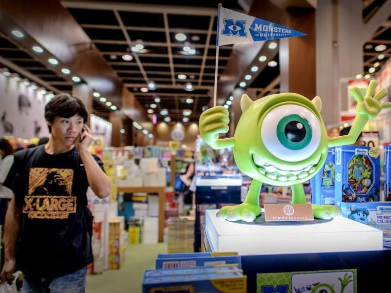 A man walks past an animated movie character figure (R) displayed at the Hong Kong Book Fair. Photo: AFP / Philippe Lopez