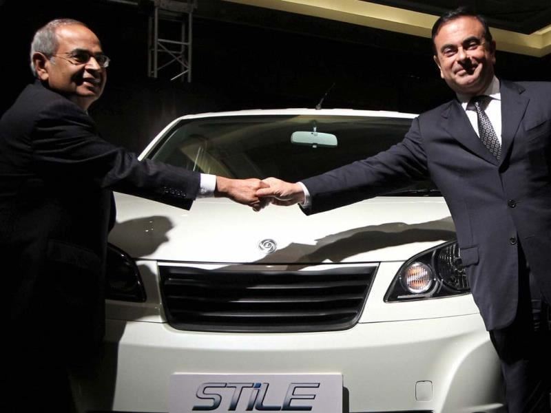 Renault-Nissan Alliance CEO and Chairman Carlos Ghosn along with Hinduja Group Co-Chairman G P Hinduja at the unveiling of Ashok Leyland's new Model Stile. Photo: PTI/R Senthil Kumar