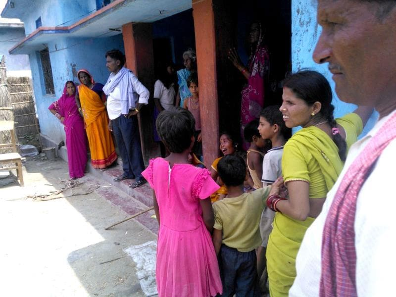 Mourning relatives of three brothers, who were among the 22 children who died in Chhapra after consuming contaminated mid-day meals. (HT Photo)