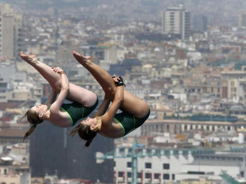 Australia's Emily Boyd, left, and Lara Tarvit perform during a 10-meter platform diving training session ahead of the FINA Swimming World Championships in Barcelona, Spain. AP Photo