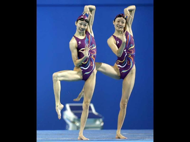 Jiang Wenwen and her sister Jiang Tingting from China perform during a duet synchronized swimming training session ahead of the FINA Swimming World Championships in Barcelona, Spain. AP Photo