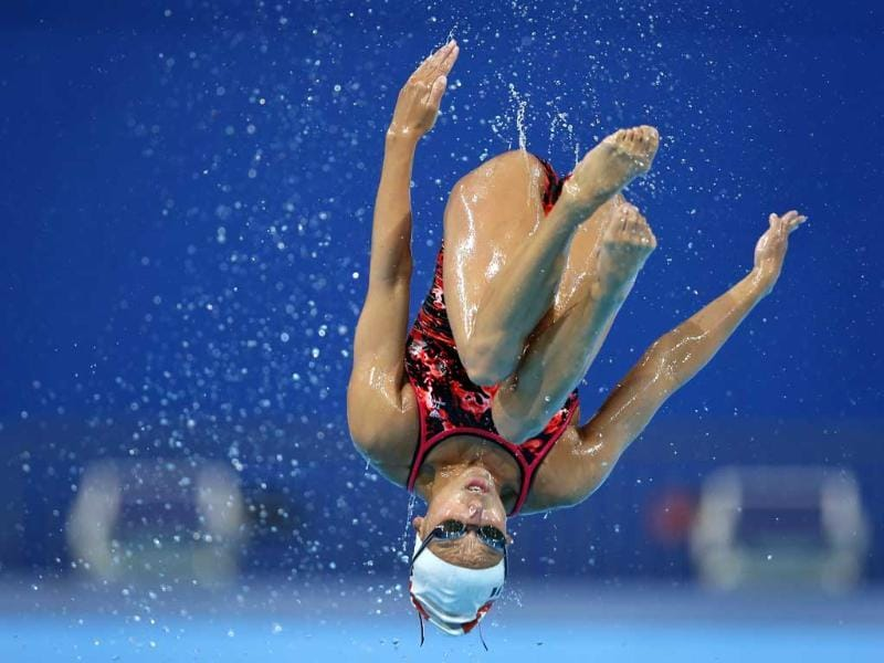 Switzerland's Pamela Fischer is thrown up in the air during a training session of the synchronized swimming team ahead of the FINA Swimming World Championships in Barcelona, Spain. AP Photo