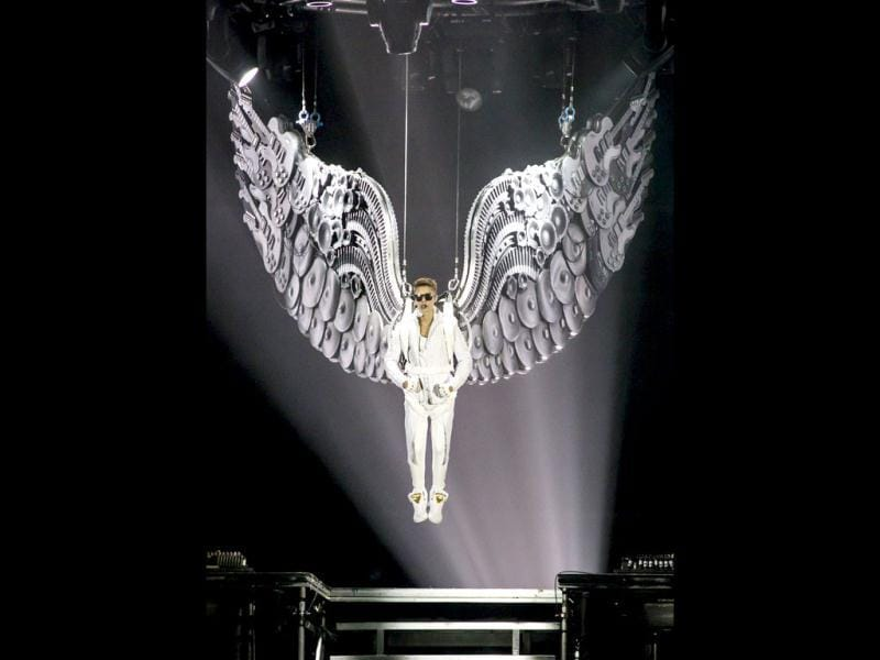 Justin Bieber is lowered onto the stage during a concert at the Wells Fargo Center on Wednesday, July 17, 2013 in Philadelphia. AP