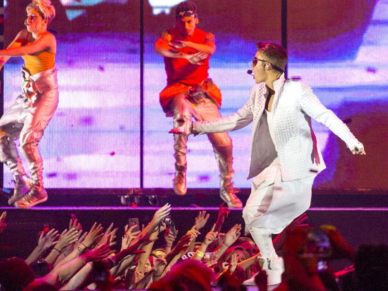 Justin Bieber performs in a concert at the Wells Fargo Center on Wednesday, July 17, 2013 in Philadelphia. AP