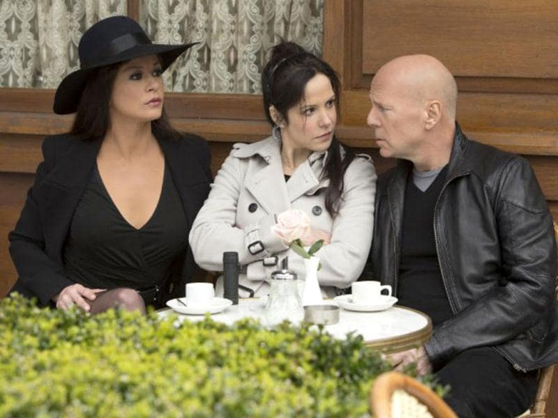 Catherine Zeta Jones and Mary-Louise Parker (centre), seen here with Bruce Willis, play the femme fatales in Red 2.