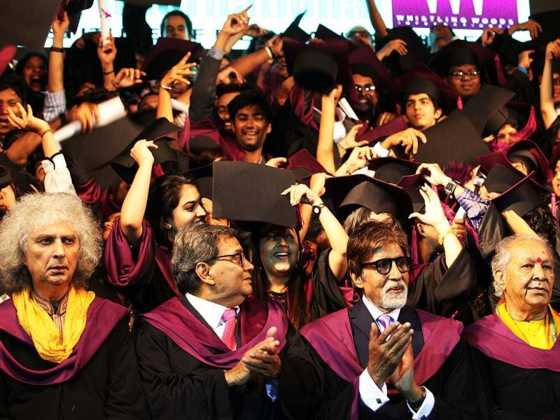 Whistling Woods graduates about to throw their caps.