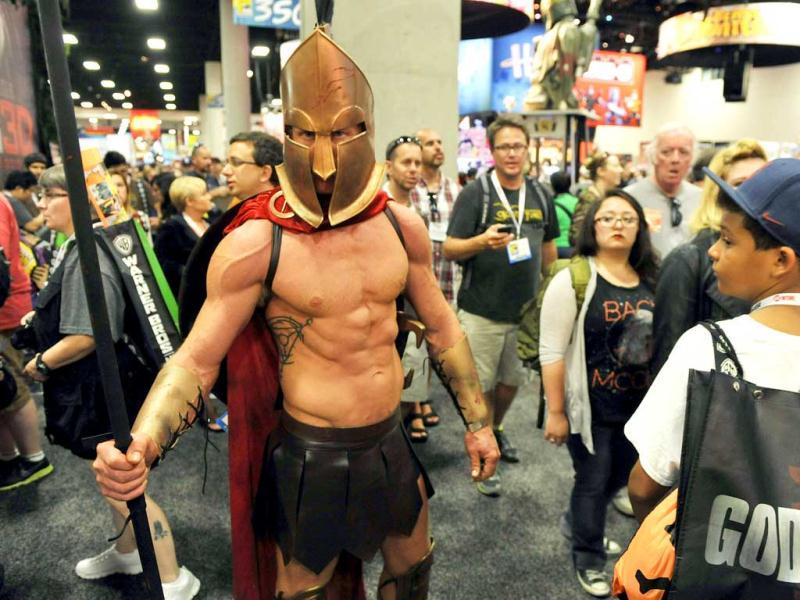 Dressed as a Trojan soldier, Todd Schmidt of San Diego, makes his way through the crowd during the preview night event on day 1 of the 2013 Comic-Con International Convention in San Diego. (AP Photo)