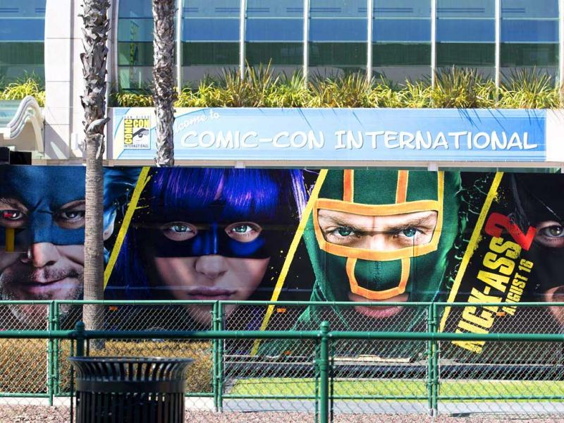 A bus with an advertisement for the movie Kick-Ass 2 drives past the San Diego Convention Center a day before the start of the 2013 Comic-Con in San Diego, California. (Reuters photos)