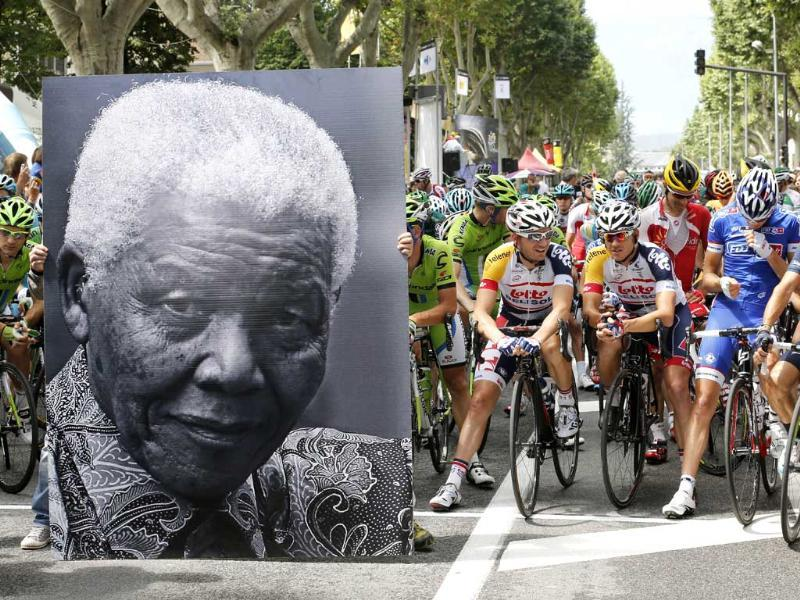 A portrait of Nelson Mandela is displayed in front of cyclists to celebrate the birthday of former South African president Nelson Mandela in Gap, before the start of the 172.5 km eighteenth stage of the 100th edition of the Tour de France cycling race. AFP photo