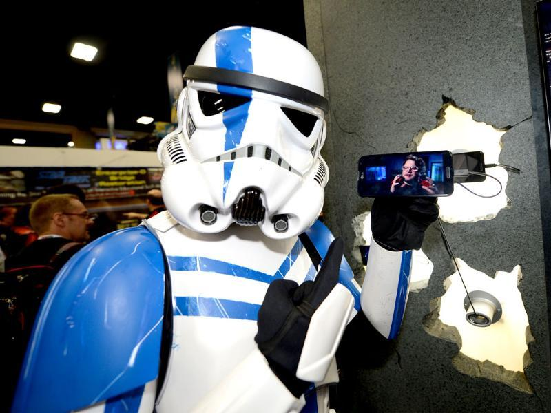 A stormtroop commander holds the latest LG smartphone, LG Optimus G Pro, at the Legendary Entertainment booth at Comic-Con International 2013 in San Diego. (AP Photo)