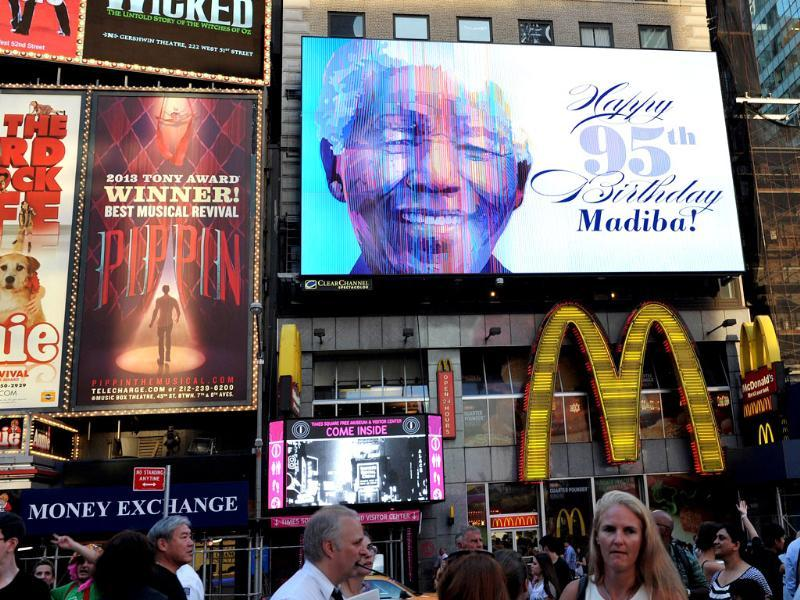 An electronic billboard flashes a birthday greeting to Nelson Mandela in New York's Times Square.