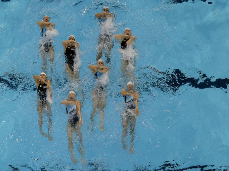 Japan's synchronized swim team perform their routine during a training session ahead of the FINA Swimming World Championships in Barcelona, Spain. (AP Photo)