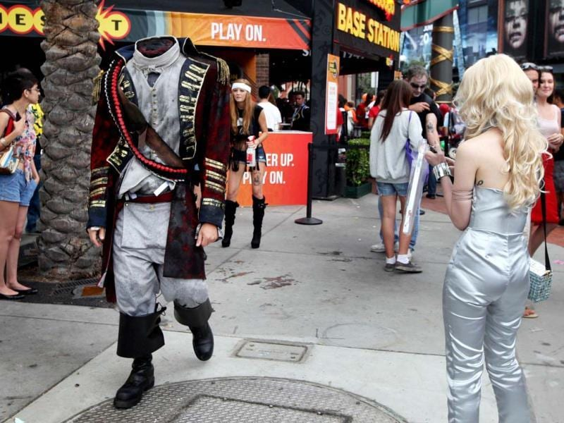 An attendee dressed as a headless pirate walks down Fifth Avenue during Comic Con in San Diego, California. (AFP Photo)