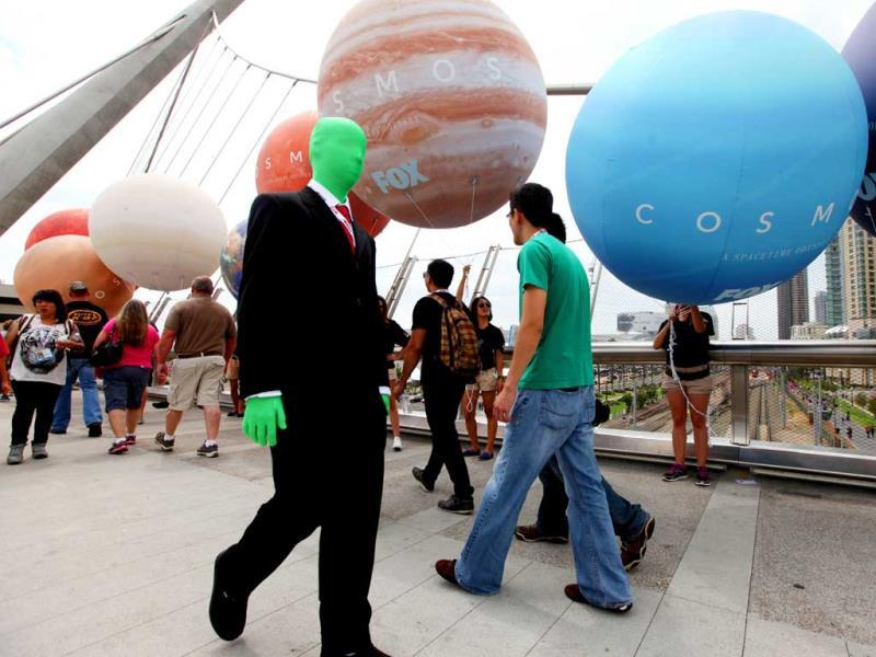 Costumed attendees walk on an overpass bridge during Comic Con in San Diego, California. (AFP Photo)