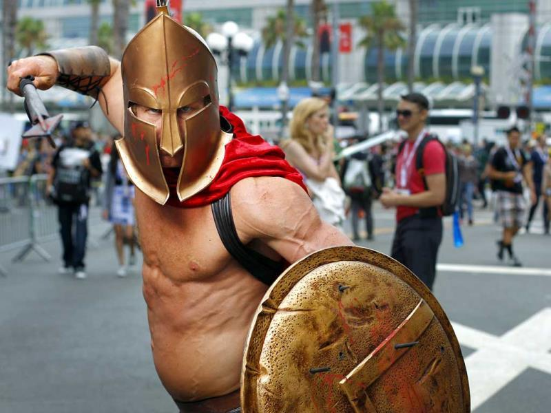Todd Schmidt, dressed as a Spartan, poses for a photo during Comic Con in San Diego. (AP Photo)