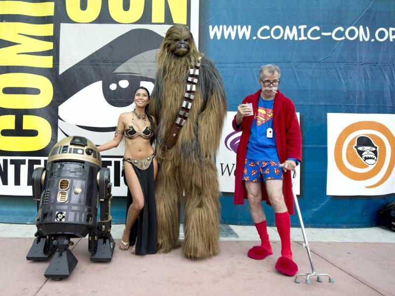 People in an eclectic collection of costumes pose together for a photo at Comic Con 2013 at the San Diego Convention Center in California. (AFP Photo)