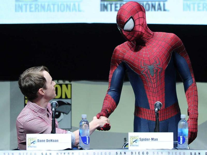 Actor Dane DeHaan (L) and Spider-Man speak onstage at the Sony and Screen Gems panel for 'The Amazing Spider-Man 2' during Comic Con International 2013 at the San Diego Convention Center in California. (AFP Photo)