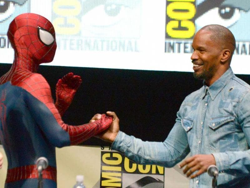 Spider-Man (L) and Jamie Foxx attend the 'The Amazing Spider-Man 2' panel on Day 3 of Comic Con International in San Diego. (AP Photo)